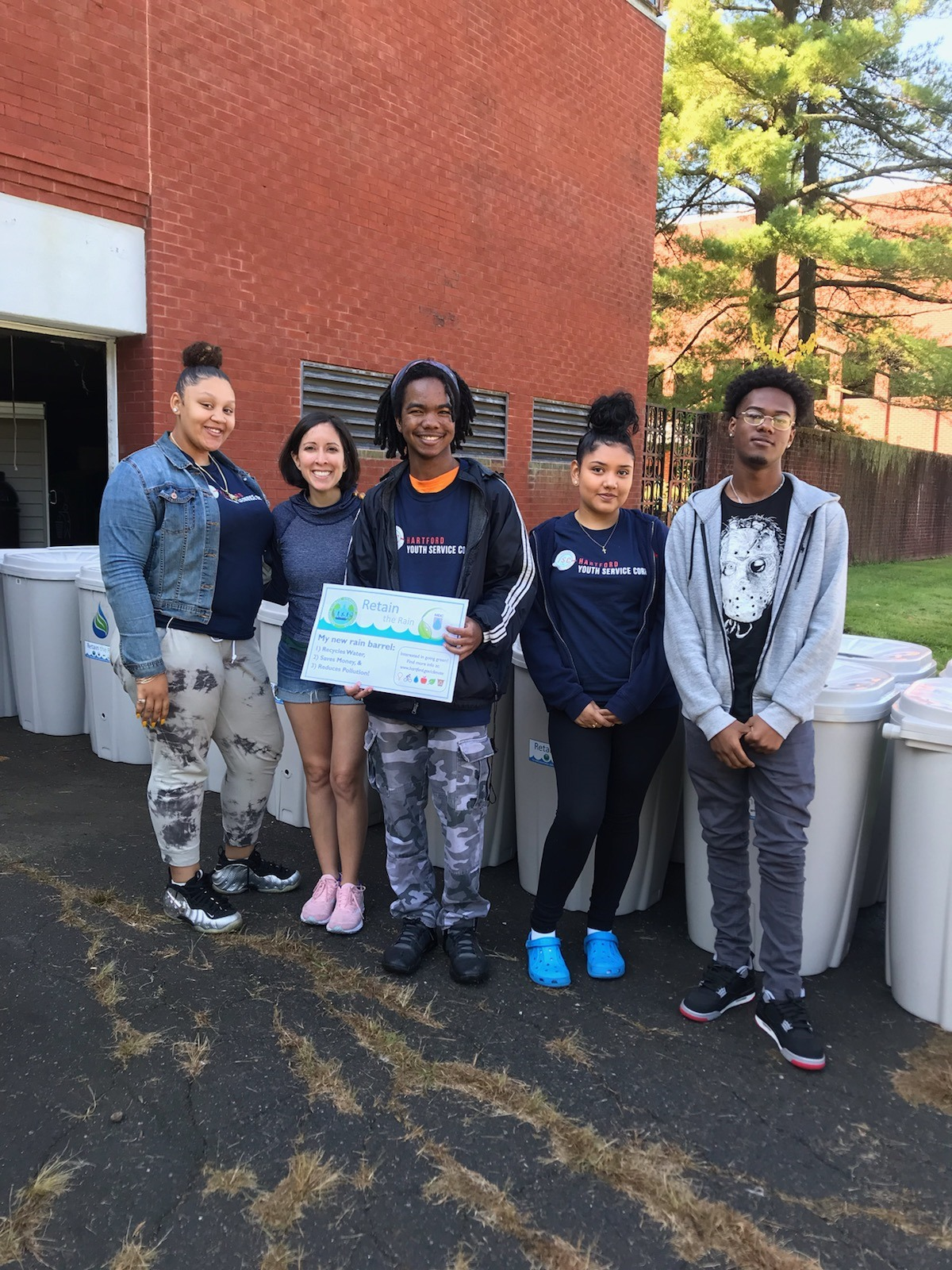 Youth Service Corps Members help give out rain barrels